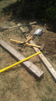 Shovels, pick ax, post hole digger and sledge hammer for setting posts